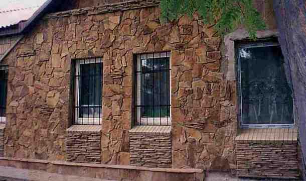 обробка фасаду натуральним та штучним каменем