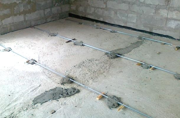 встановлення маяків для бетонної стяжки